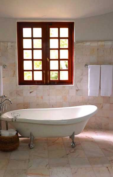 shower-to-tub-remodeling-contractor-with-tile-throughout-bathroom-and-colorful-window-to-enhance-custom-home-design-in-west-phoenix-az
